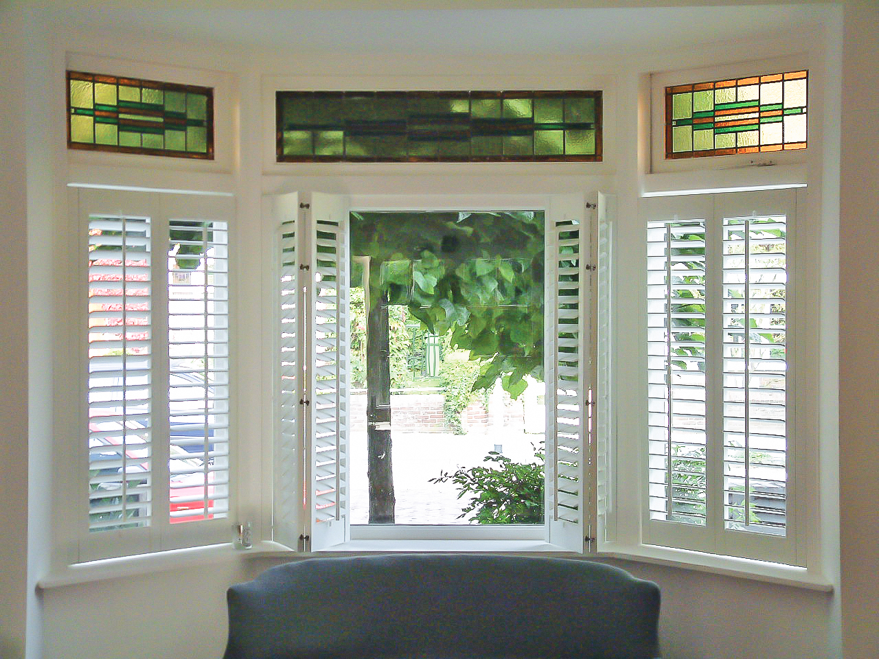we install wooden bay window shutters in Sussex and London